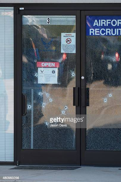 Bullet holes are seen in the glass of a Armed Forces Career Center/National Guard recruitment office on July 16 2015 in Chattanooga Tennessee...