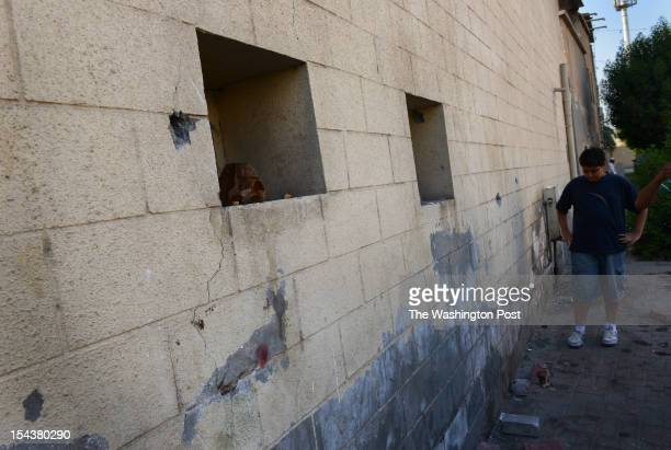 Bullet holes are visible on a block wall where gunfire was exchanged by police killing Khaled AlLabad and two teenage relatives last month in Awamiya...