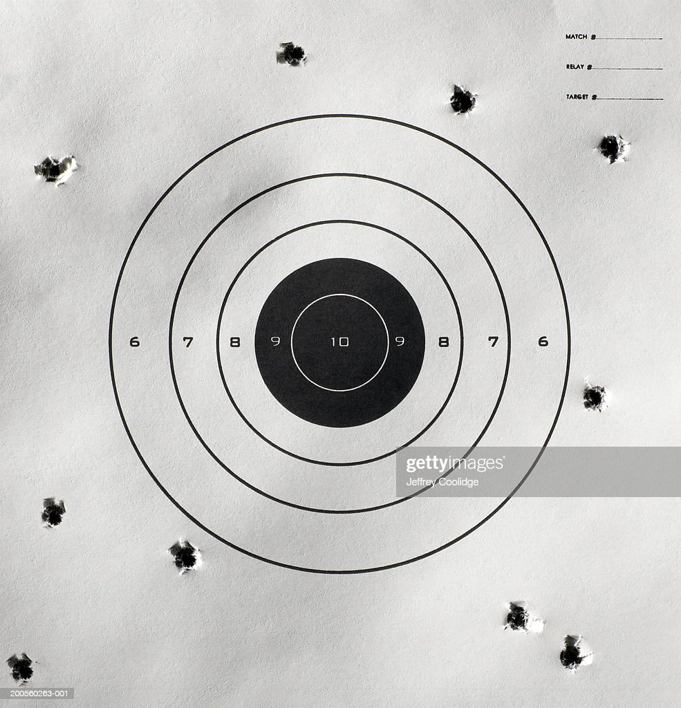 Bullet holes around bull's-eye of shooting target