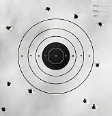 Bullet holes around bull's-eye of shooting target