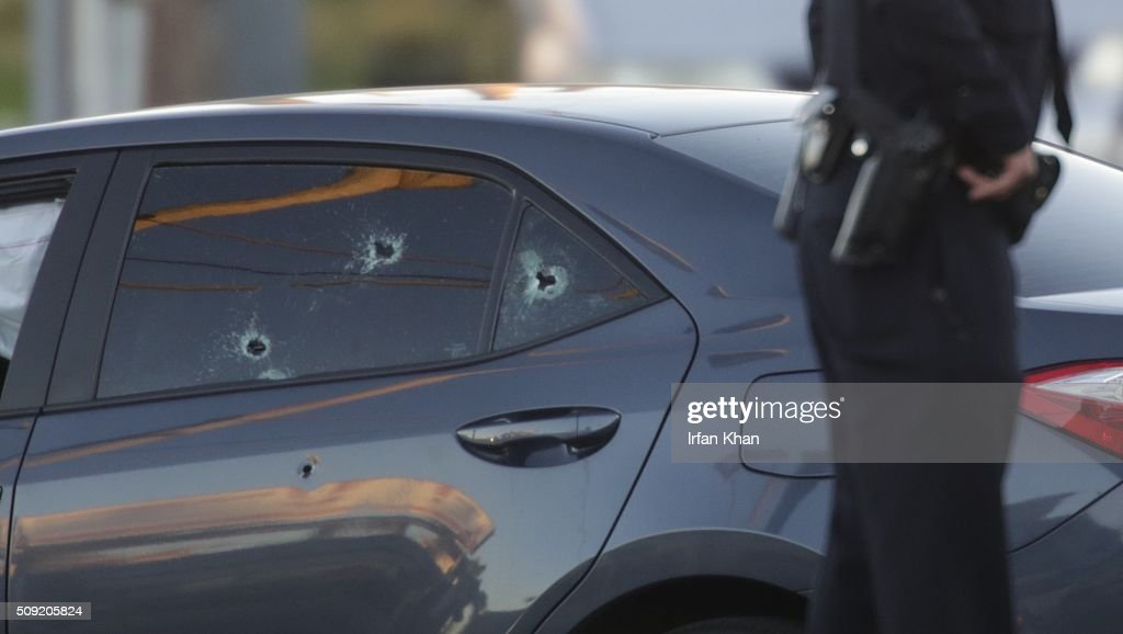 CA FEBRUARY 9, 2016 -- Bullet holes in a car with an Uber sticker near the intersection of Griffin Avenue and North Broadway in the Lincoln Heights area of Los Angeles Tuesday morning, February 9, 2016. The driver of the car was pronounced dead at the scene.