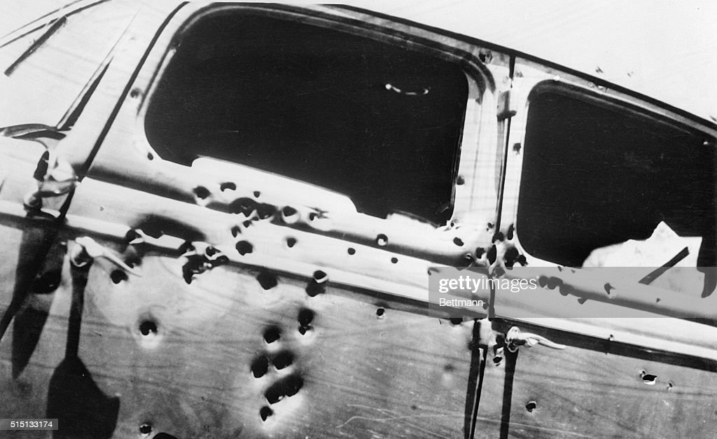 Bullet holes in the V-8 sedan in which Clyde Barrow, Southwest desperado, and his woman companion, Bonnie Parker, were shot to death near Arcadia, La., May 23rd, by six officers. The window of the auto was shot away. There are at least 70 bullet holes shown here.