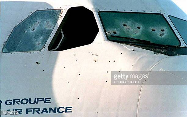 Bullet holes in the windows and fuselage of an Air France Airbus A300 show 27 December the damage incurred during the plane's liberation at the...