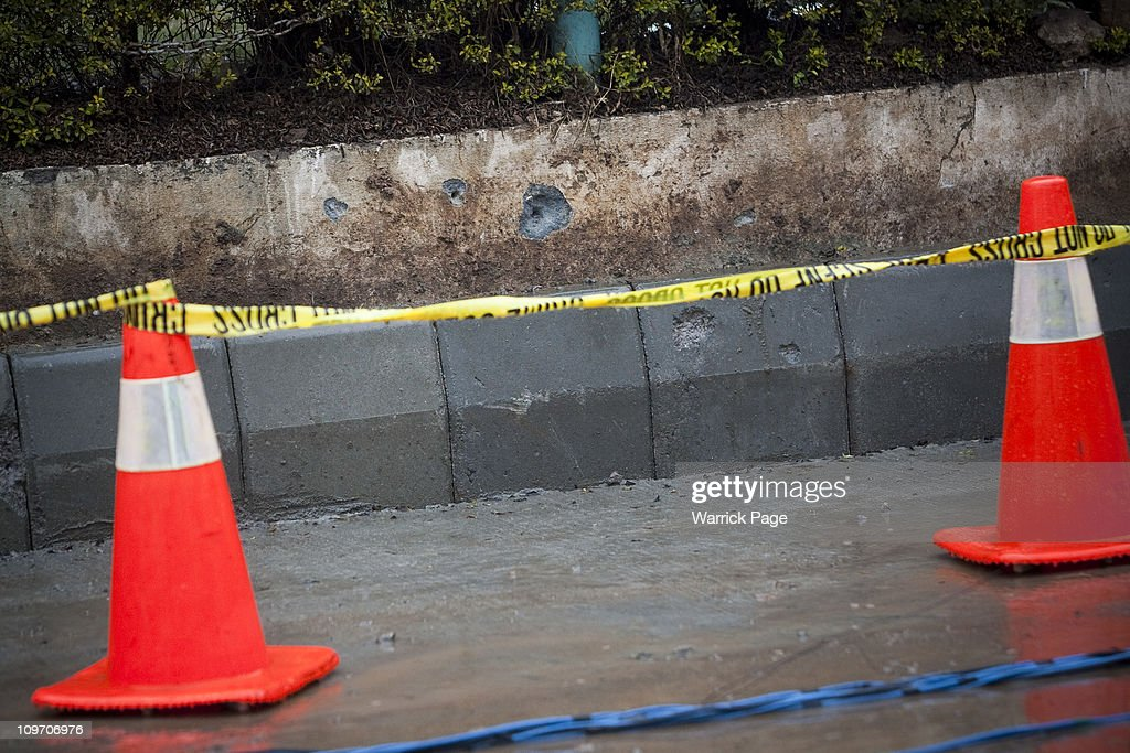 Bullet holes pepper the sidewalk where Pakistan Minority Minister Shahbaz Bhatti's was gunned down near his mother's home on March 2 2011 in...