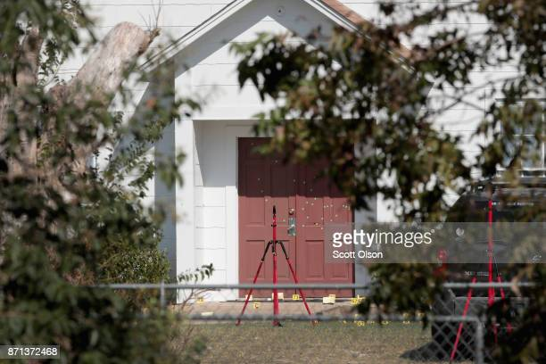 Bullet holes scar the front door of the First Baptist Church of Sutherland Springs on November 7 2017 in Sutherland Springs Texas On November 5 a...