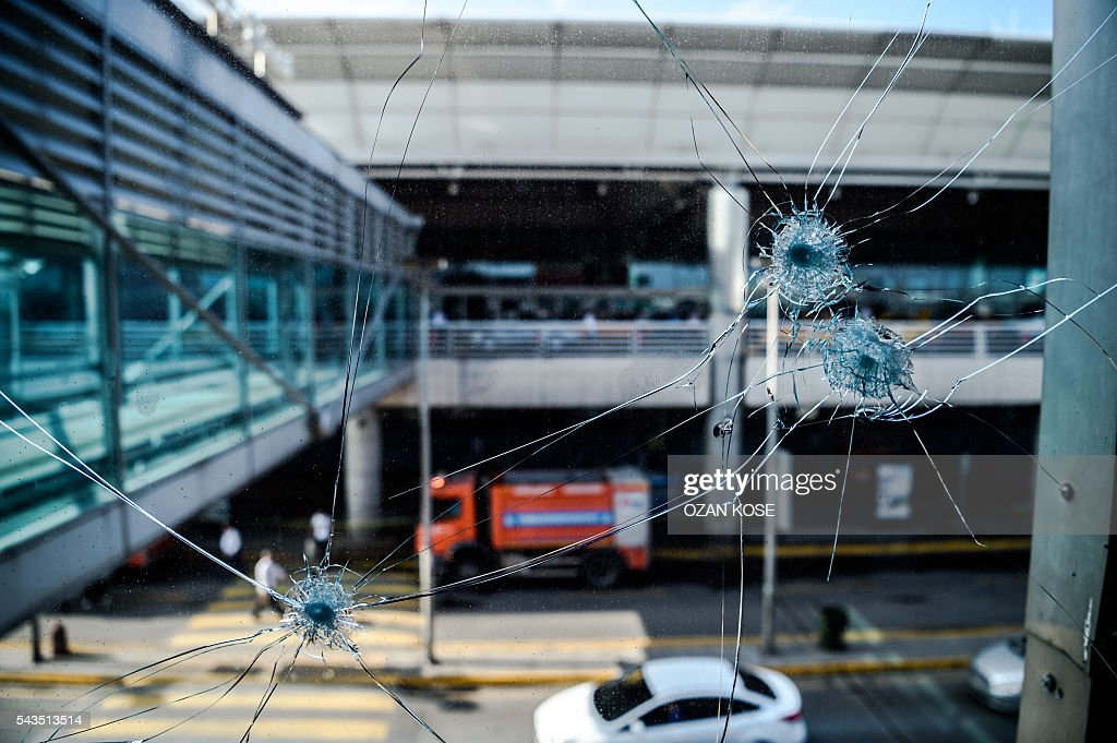Bullet impacts are pictured at Ataturk airport's International airport on June 29, 2016, a day after a suicide bombing and gun attack targeted Istanbul's airport, killing at least 36 people. A triple suicide bombing and gun attack that occurred on June 28, 2016 at Istanbul's Ataturk airport has killed at least 36 people, including foreigners, with Turkey's prime minister saying early signs pointed to an assault by the Islamic State group. / AFP / OZAN