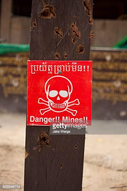 Bullet riddled Landmine Caution sign, Preah Vihear temple, Cambodia