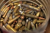 Bullet rounds sit in a container at the Article 2 Gun Store in Lombard Illinois US on Monday July 8 2013 Illinois lifted its prohibition against...