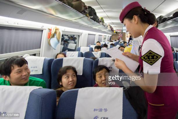A bullet train attendant checks takeout food orders with passengers who order food online on July 17 2017 in Changsha Hunan Province of China...