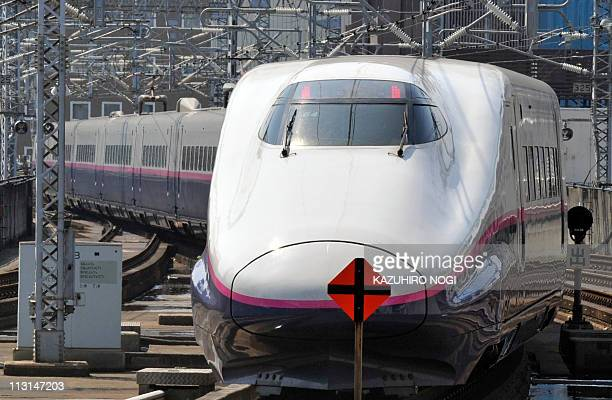 A bullet train departs for Tokyo at Sendai Station in Miyagi prefecture on April 25 2011 The shinkansen service on the Tohoku Shinkansen Line resumed...
