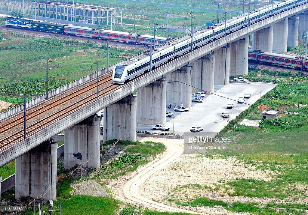 A bullet train runs past the site where two Chinese bullet trains collided and killed more than 40 passengers and 200 injured, on July 13, 2012 in Wenzhou, Zhejiang Province, China. The wreckage of the crashed train were removed and the land where authority had hidden the carriage had been leveled.