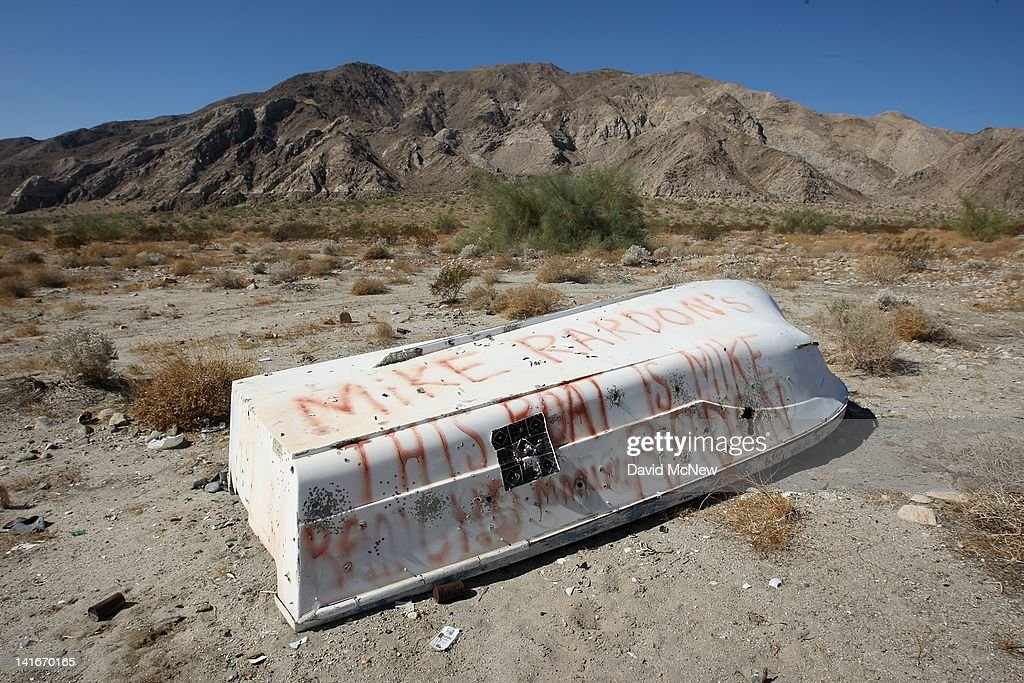 A bullet-and shotgun pellet-riddled boat is seen abandoned near Travertine Point in an area where a controversial development would create a new town for nearly 40,000 people on the northwest shore of the biggest lake in California, the Salton Sea, on March 21, 2012 south of Mecca, California. The Center for Biological Diversity and the Sierra Club have filed a lawsuit against Riverside County after the Board of Supervisors approved a record-sized development project for Riverside County, saying that it would increase pollution and threaten wildlife in nearby parks at the Salton Sea and in the largest state park in California, Anza-Borrego Desert State Park. Though massive fish die-offs occur annually, drawings in the Travertine Point plans feature peaceful marinas but the lake has been plagued by dropping water levels and increasing salt levels for decades. Scientists say that a catastrophic decline in the fish population is inevitable and a resulting 25 to 50 percent drop in the migratory bird population will destroy a major stopping point in the Pacific bird migration route. The shrinking salt lake is exposing more and more fine dust, posing health problem as blows it across the region. Funding to stop the ecological collapse of the sea is not likely in the near futures with its $9 billion price tag.