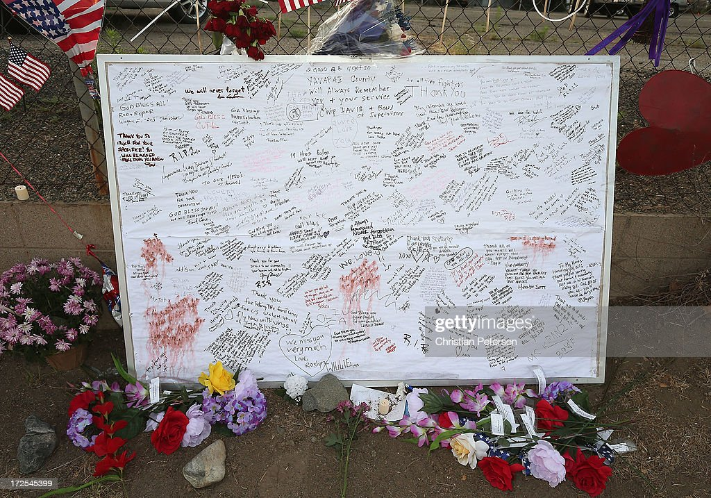 A bulletin board filled with caring messages leans on the fence outside of Station 7 on July 3, 2013 in Prescott, Arizona. Nineteen firefighters based out of Station 7 died battling a fast-moving wildfire near Yarnell, Arizona on June 30. Station 7 has been the home of the Granite Mountain Interagency Hotshot Crew since 2010.
