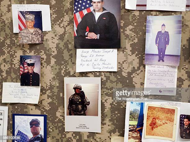A bulletin board in the break room of Bluewater Defense decorated with portraits of relatives of employees who serve or have served in the US armed...