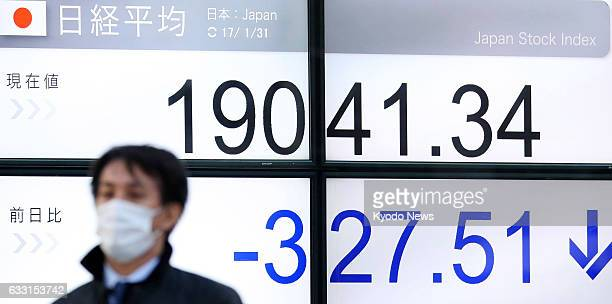A bulletin board in Tokyo shows the key Nikkei stock index dropping over 300 points on Jan 31 dragged down by concern over US President Donald...
