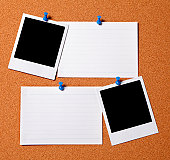 Bulletin board with blank photo prints and cards