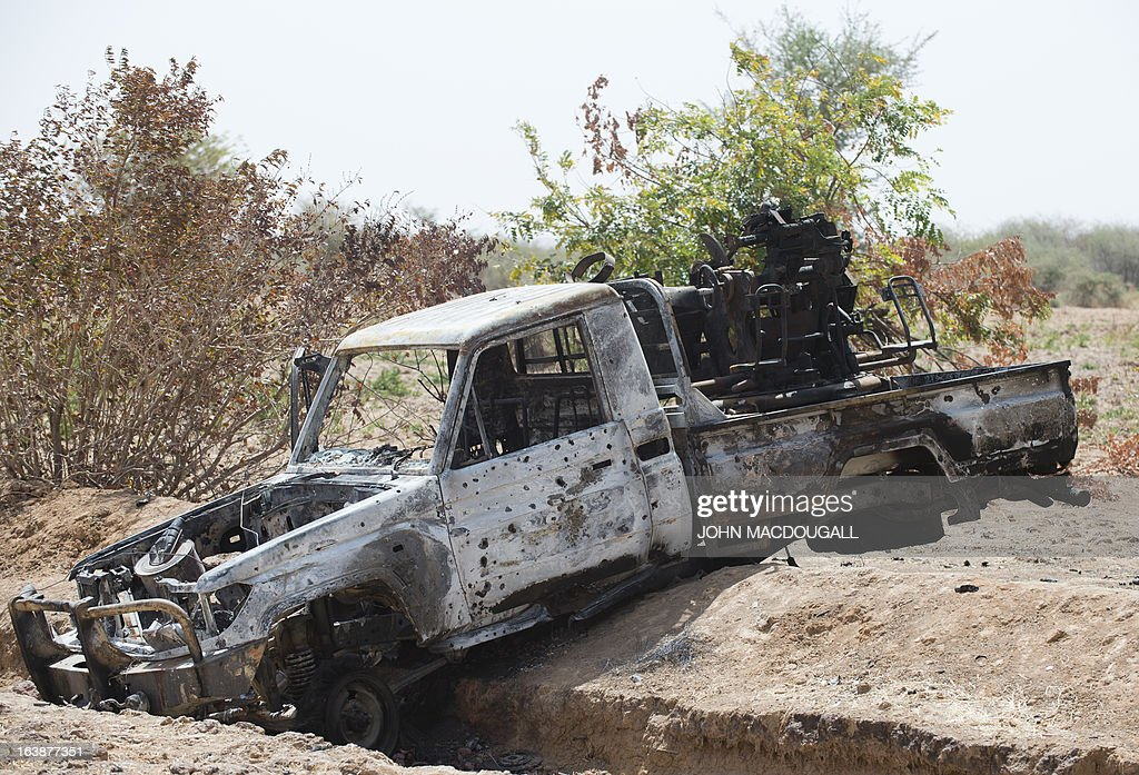 A bullet-ridden pickup truck belonging to Islamic extremists lies in a ditch off the road outside the central Malian town of Kona March 8, 2013.