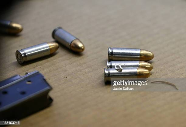 Bullets and a clip from a gun that was surrendered sit on a table during a gun buy back program on December 15 2012 in San Francisco California The...