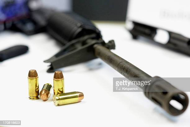 Bullets and various gun parts sit on display at a demonstration about recovering DNA evidence from items that a suspect has simply touched during a...