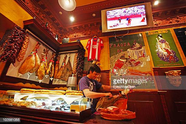 A bullfight is shown on a TV at the La Fragua de Vulcano a typical Spanish restaurant bar and taverna in the center of Madrid on May 21 2010 in...