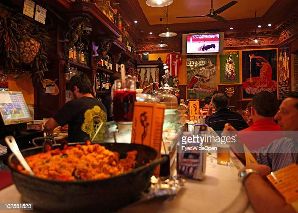 A bullfight is shown on a TV at theLa Fragua de Vulcano a typical Spanish restaurant bar and taverna in the center of Madrid on May 21 2010 in Madrid...