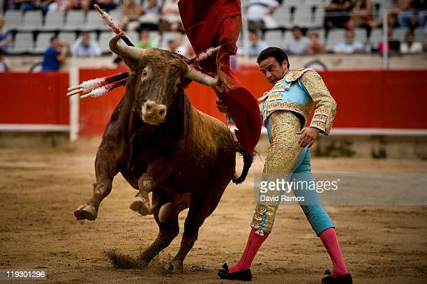 Bullfighter Enrique Ponce of Spain performs during the third bullfight of the 2011 season at the Monumental bullring on July 17 2011 in Barcelona...