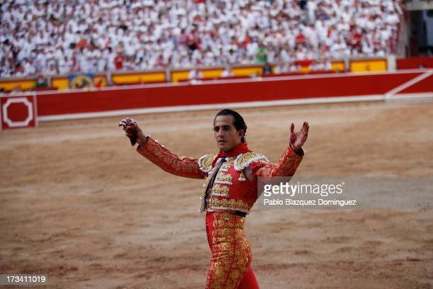 Bullfighter Ivan Fandino celebrates his performance with a Fuente Ymbro's fighting bull on the eighth day of the San Fermin Running Of The Bulls...