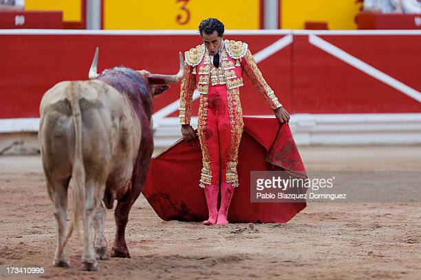 Bullfighter Ivan Fandino performs with a Fuente Ymbro's fighting bull on the eighth day of the San Fermin Running Of The Bulls festival on July 13...
