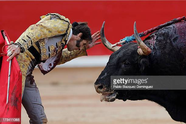 Bullfighter Juan Jose Padilla performs with a Fuente Ymbro's fighting bull on the eighth day of the San Fermin Running Of The Bulls festival on July...