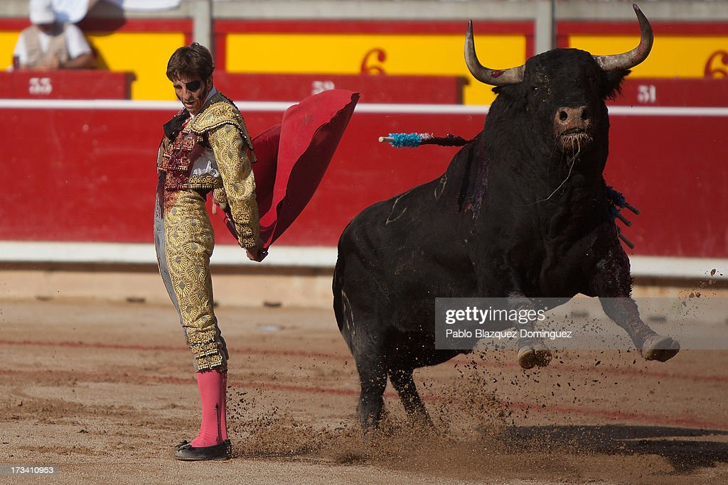 Bullfighter <a gi-track='captionPersonalityLinkClicked' href=/galleries/search?phrase=Juan+Jose+Padilla&family=editorial&specificpeople=594407 ng-click='$event.stopPropagation()'>Juan Jose Padilla</a> performs with Fuente Ymbro's fighting bulls entering the bullring during the eighth day of the San Fermin Running Of The Bulls festival on July 13, 2013 in Pamplona, Spain. The annual Fiesta de San Fermin, made famous by the 1926 novel of U.S. writer Ernest Hemmingway 'The Sun Also Rises,' involves the running of the bulls through the historic heart of Pamplona, this year for nine days from July 6-14.