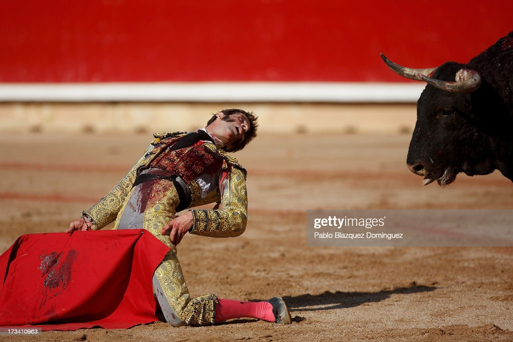 Bullfighter <a gi-track='captionPersonalityLinkClicked' href=/galleries/search?phrase=Juan+Jose+Padilla&family=editorial&specificpeople=594407 ng-click='$event.stopPropagation()'>Juan Jose Padilla</a> performs with Fuente Ymbro's fighting bulls on the eighth day of the San Fermin Running Of The Bulls festival on July 13, 2013 in Pamplona, Spain. The annual Fiesta de San Fermin, made famous by the 1926 novel of U.S. writer Ernest Hemmingway 'The Sun Also Rises,' involves the running of the bulls through the historic heart of Pamplona, this year for nine days from July 6-14.