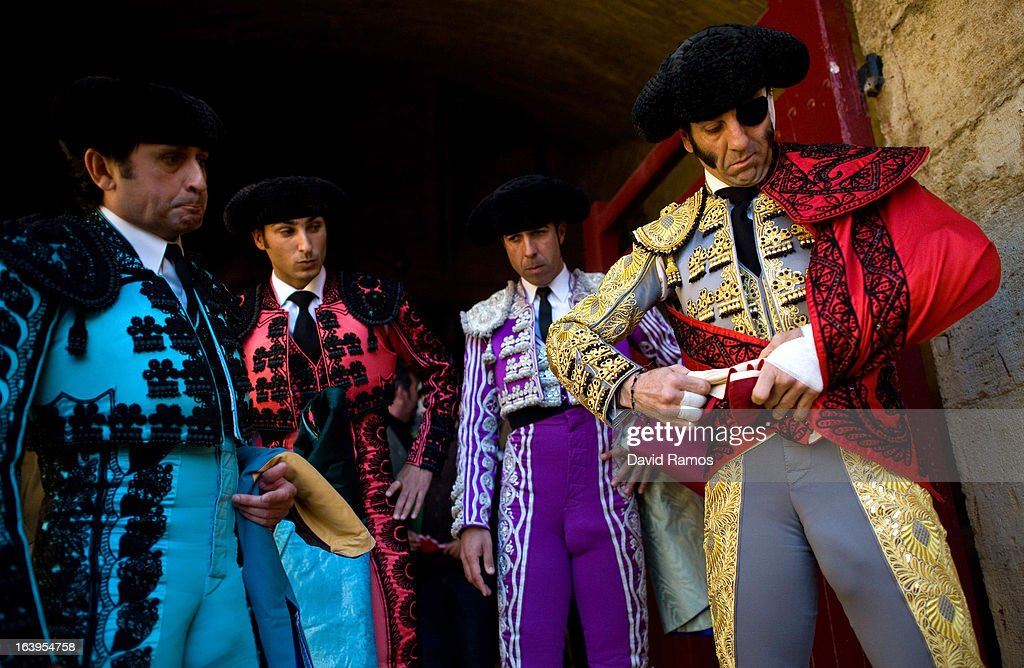 Bullfighter Juan Jose Padilla (R) puts on his costume with help from his assitants before a bullfight as part of the Las Fallas Festival on March 18, 2013 in Valencia, Spain. The Fallas festival, which runs from March 15 until March 19, celebrates the arrival of spring with fireworks, fiestas and bonfires made from large ninots (puppets).