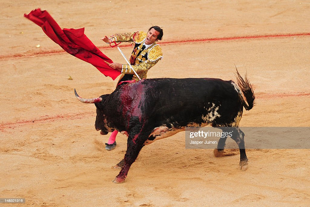 Bullfighter Ivan Fandino of Spain jumps to push his sword into an El Pilar fighting bull to kill it on the fourth day of the San Fermin running-of-the-bulls on July 10, 2012 in Pamplona, Spain.