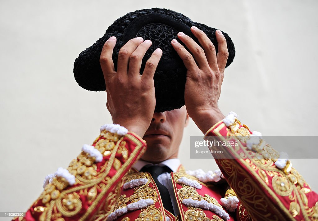 Bullfighter Matias Tejela of Spain puts on his montera as he prepares to enter the bullring for a bullfight on the fourth day of the San Fermin running-of-the-bulls on July 10, 2012 in Pamplona, Spain.