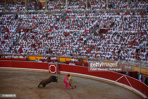 Bullfighter Morenito Aranda performs during a bullfight on the third day of the San Fermin Running Of The Bulls festival on July 8 2015 in Pamplona...