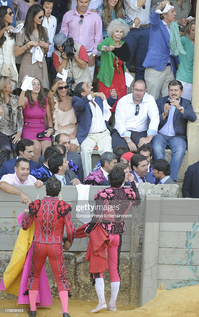 Bullfighters dedicate their 'faena' to Duchess of Alba, <a gi-track='captionPersonalityLinkClicked' href=/galleries/search?phrase=Cayetana+Fitz-James+Stuart&family=editorial&specificpeople=6090682 ng-click='$event.stopPropagation()'>Cayetana Fitz-James Stuart</a> (wearing in green and red), who is sitting next to her boyfriend <a gi-track='captionPersonalityLinkClicked' href=/galleries/search?phrase=Alfonso+Diez&family=editorial&specificpeople=6697714 ng-click='$event.stopPropagation()'>Alfonso Diez</a>. Cayetano Rivera's girlfriend <a gi-track='captionPersonalityLinkClicked' href=/galleries/search?phrase=Eva+Gonzalez&family=editorial&specificpeople=242818 ng-click='$event.stopPropagation()'>Eva Gonzalez</a> (brown dress and sunglasses) is looking them during the 'Goyesca' Bullfights on September 3, 2011 in Ronda, Spain. The bullfight events, linked to The Feria Goyesca (Feria de Pedro Romero), stem from the inter-relationship of three main personae which spanned over three centuries, all of whom have strong connections to Ronda. These are the famous 18th century bullfighter, Pedro Romero; the 18th century Spanish painter, Francisco de la Goya; and also the 20th century bullfighter, Antonio Ordonez, to whom the vision of the Ronda's modern Feria Goyesca can be attributed.