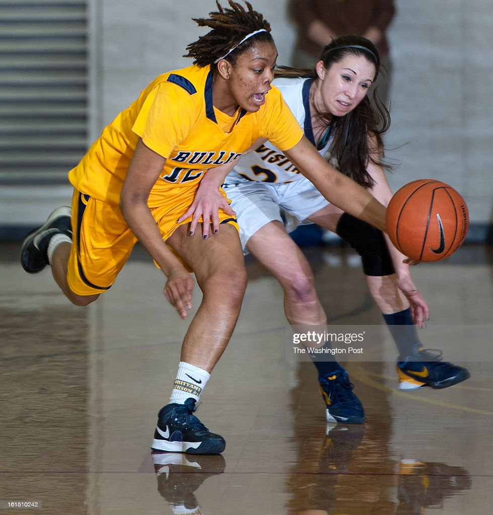 Bullis Brittany Jackson and Visitation's Taylor Delgado chase down a loose ball in the second half Monday, February 11, 2013 in Washington, DC. Visitation beat visiting Bullis 75-58.