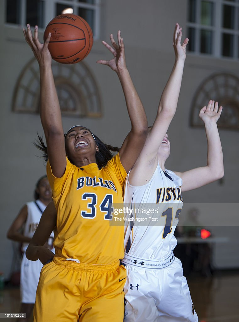 Bullis Lynee Belton and Visitation's Sarah Tierney collide going for a rebound in the first half Monday, February 11, 2013 in Washington, DC. Visitation beat visiting Bullis 75-58.