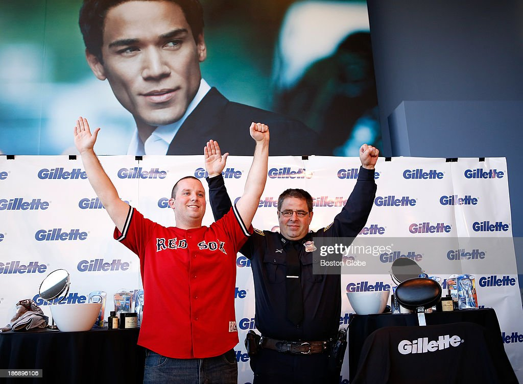 Bullpen officer Steve Horgan and fan Michael Grant, left, pose for a portrait after shaving their beards off at Gillette World Shaving Headquarters in Boston on November 4, 2013. Gillette donated $100,000 to the One Fund Boston after the shave.