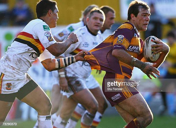 Bulls back Shontayne Hape tackles John Skandalis of the Giants during the Engage Super League match between Bradford Bulls and Huddersfield Giants at...