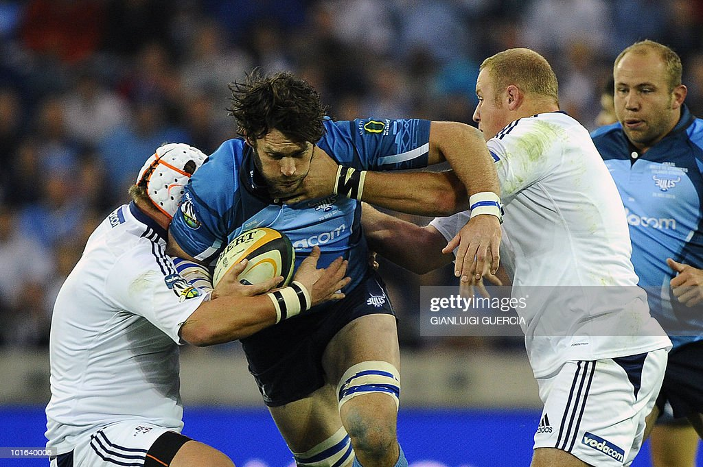 Bulls centre Danie Roussow(C) is tackled on May 29, 2010 during the Super14 Final match between Bulls and Stormers at Soweto's Orlando stadium in Johannesburg, South Africa.
