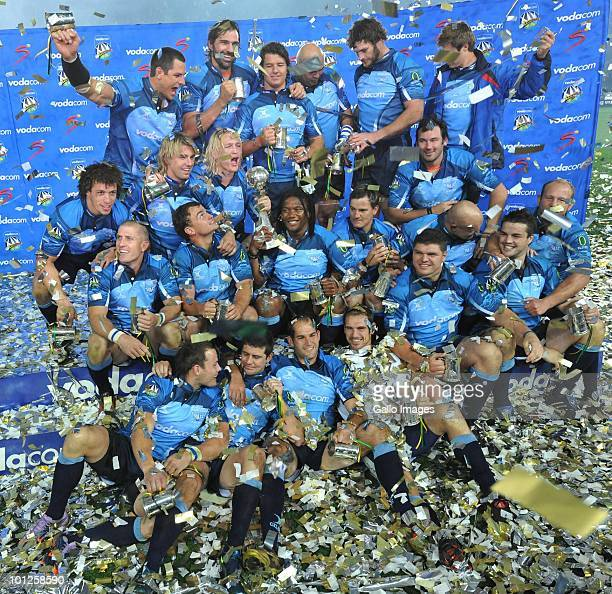 Bulls players celebrate with the trophy after winning the Super 14 final match between Vodacom Bulls and Vodacom Stormers from Orlando Stadium on May...