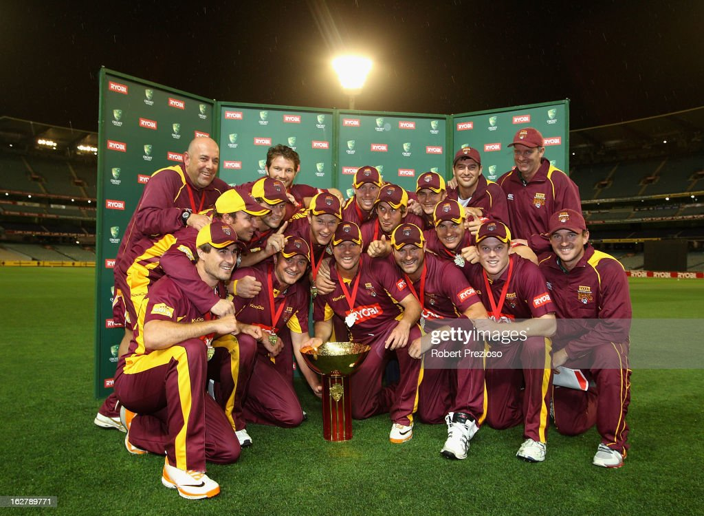 Bulls players pose with the Ryobi One Day Cup after winning the Ryobi One Day Cup final match between the Victorian Bushrangers and the Queensland Bulls at Melbourne Cricket Ground on February 27, 2013 in Melbourne, Australia.
