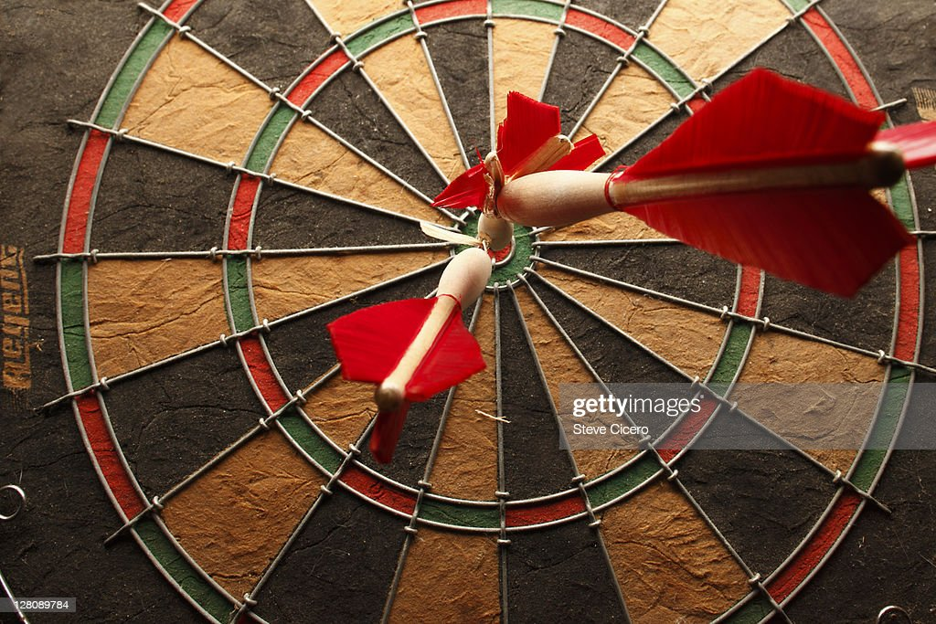 Bullseye with darts : Stock Photo