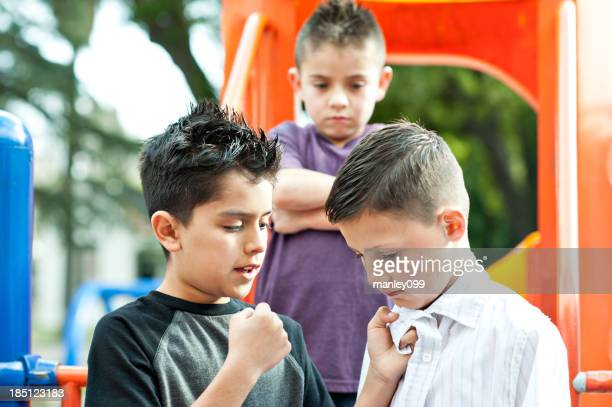 bully with fist at boy