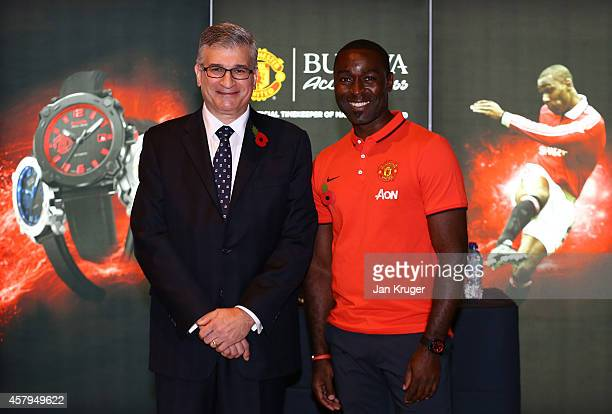 Bulova Corporation President Gregory Thumm poses with Andrew Cole during the Bulova AccuSwiss Treble Collection launch at Old Trafford on October 27...