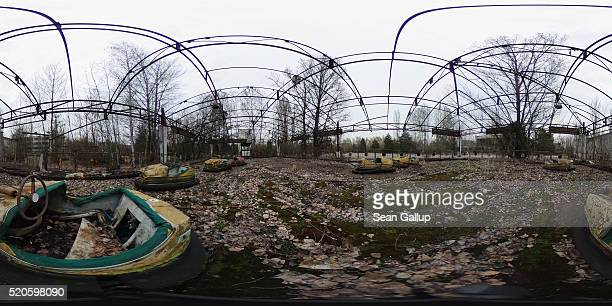Bumper cars in a former amusement park stand on April 9 2016 in Pripyat Ukraine Pripyat built in the 1970s as a model Soviet city to house the...