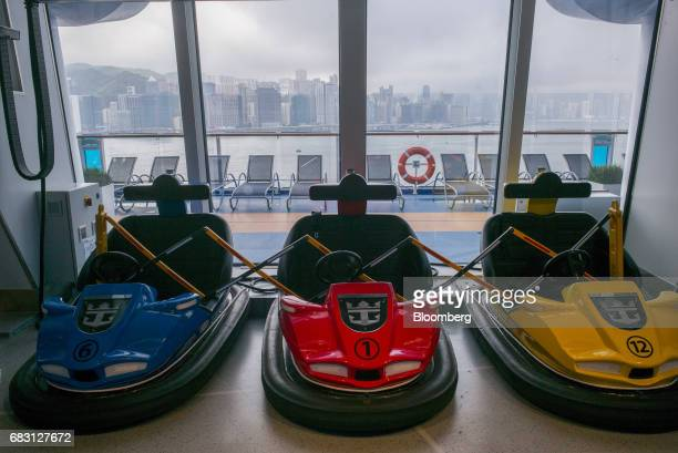 Bumper cars sit parked inside the SeaPlex indoor activity space on board the Ovation of the Seas Quantumclass cruise ship operated by Royal Caribbean...