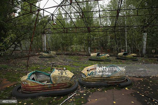 Bumper cars stand in an abandoned amusement park on September 29 2015 in Pripyat Ukraine Pripyat lies only a few kilometers from the former Chernobyl...