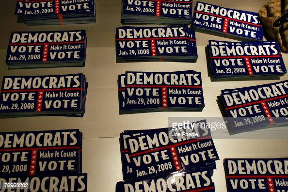 Bumper stickers encouraging Democrats to vote lie on a table as the Florida Democratic party leaders announced plans to move ahead with the state's...